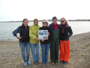 The Port Aransas crew pose with the Island Moon, the local Port A newspaper