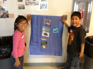 Flossie and Paul show off their diagram of a marine food web