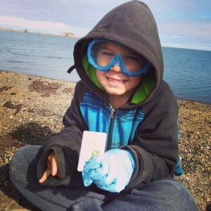 Troy demonstrates proper safety gear while analyzing water for pollutants