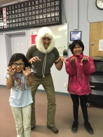 Flossie, Will, and Lenora imitating polar bears! Flossie let will try on her fox fur hat
