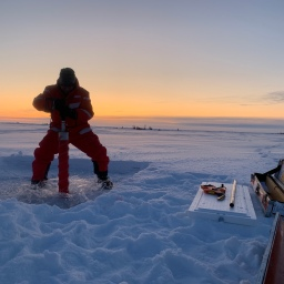 Michael Angelopolous taking the first ice core of MOSAiC!